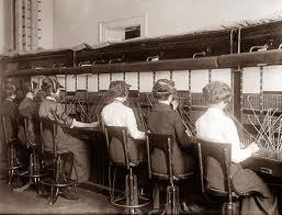Telephone operators in business answering and transferring phone calls